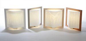 Paperivalo designvalaisin on sekä pöytävalaisin että seinävalaisin